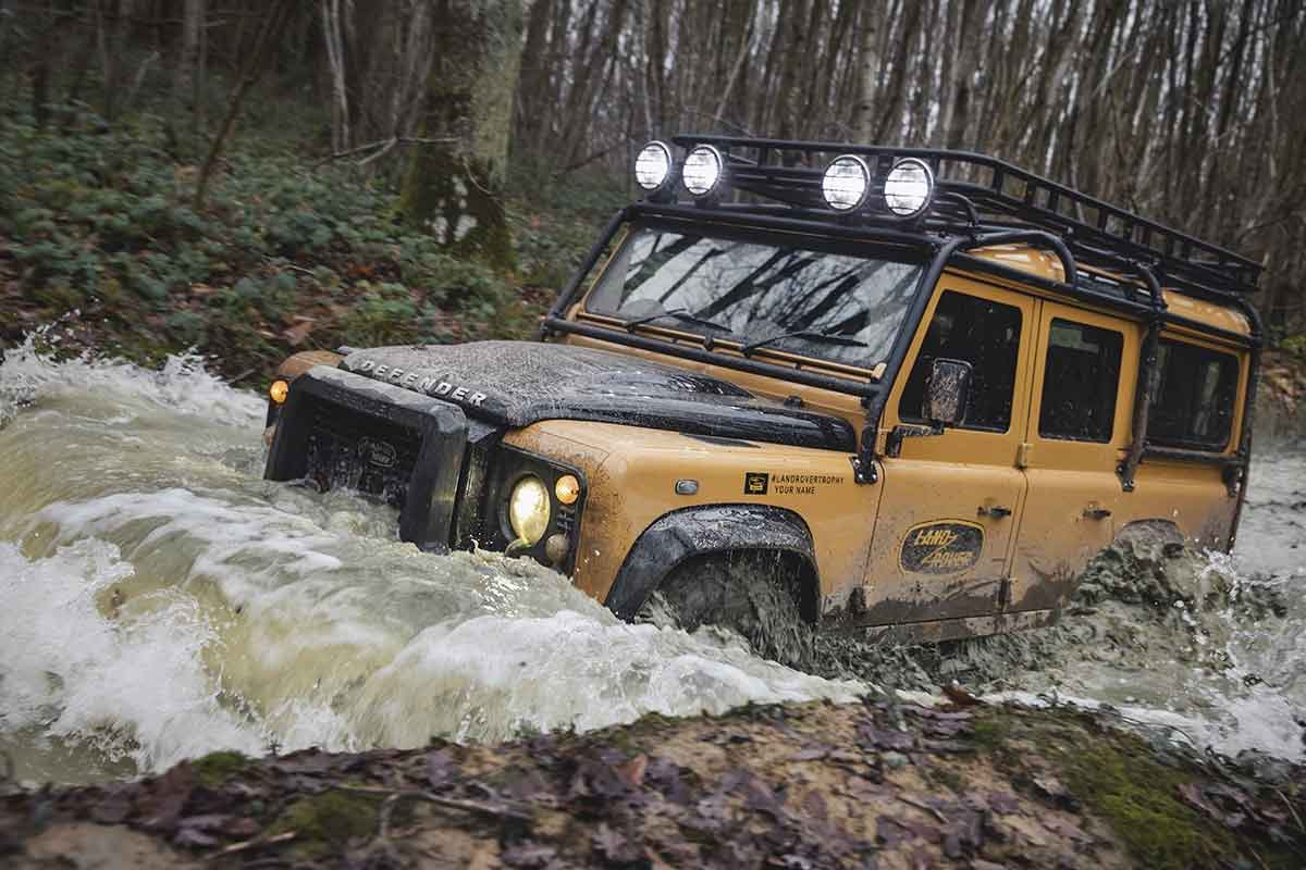 Defender driving through water