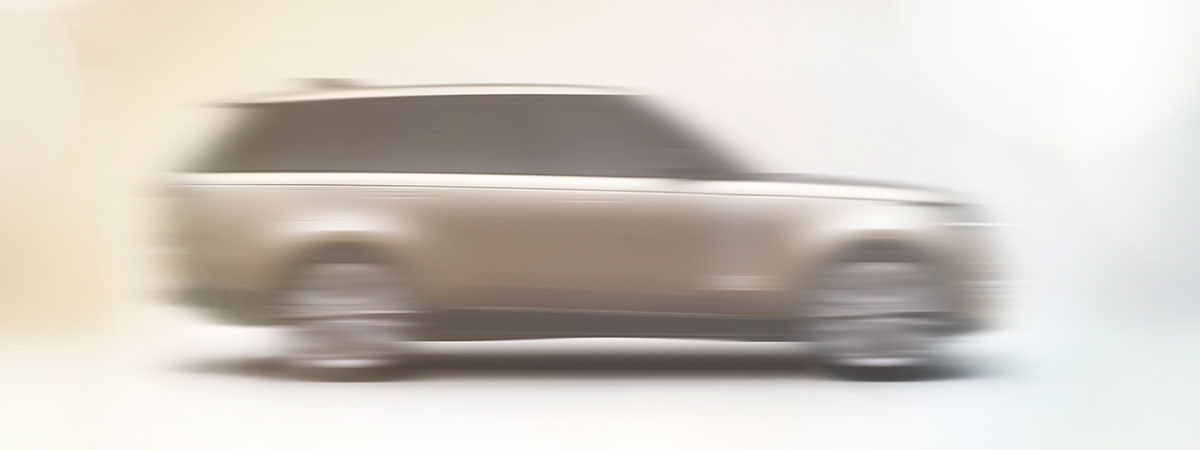 a blurred teaser image of the new 2023 Range Rover
