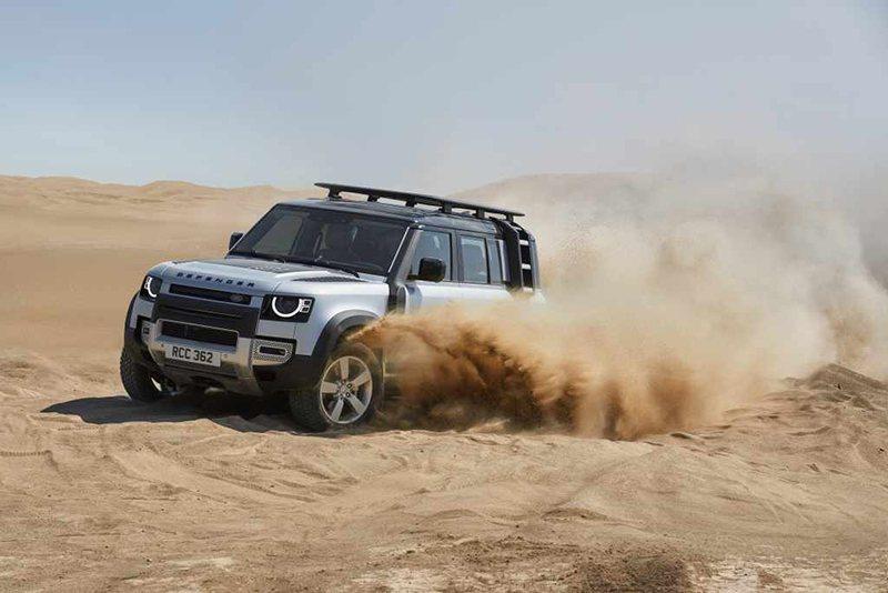 New Land Rover Defender Trekking On Sand Dunes