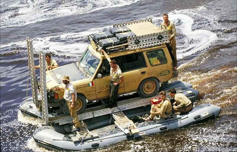 Camel Trophy 1992: Land Rover being transported on raft