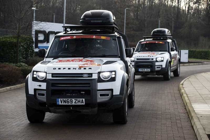 Defenders driving off for Dakar Rally