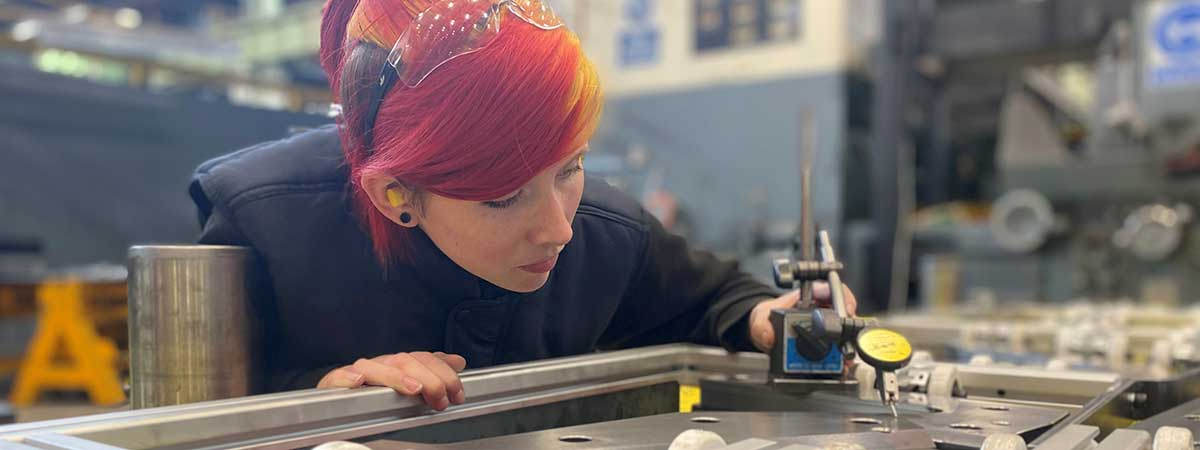 Land Rover apprentice Hannah Cocklin works with a stamping die