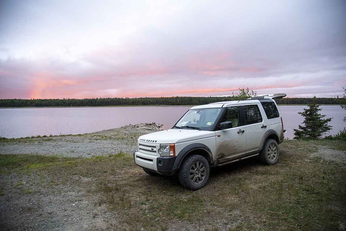 LR3 camping along lake in North Maine Woods
