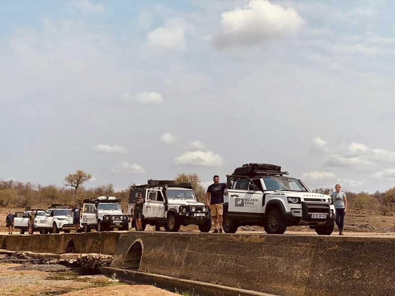 Mzansi Edge expedition lined up with their Land Rovers