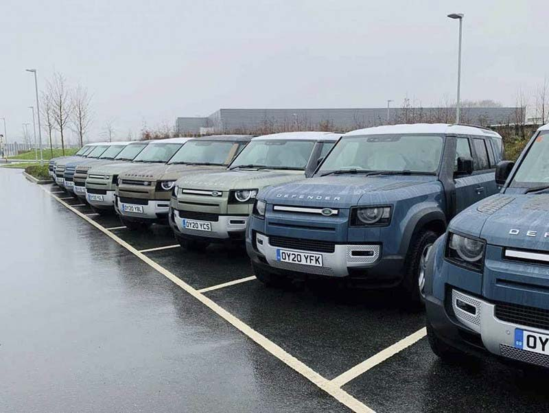 new Defender vehicles in parking lot