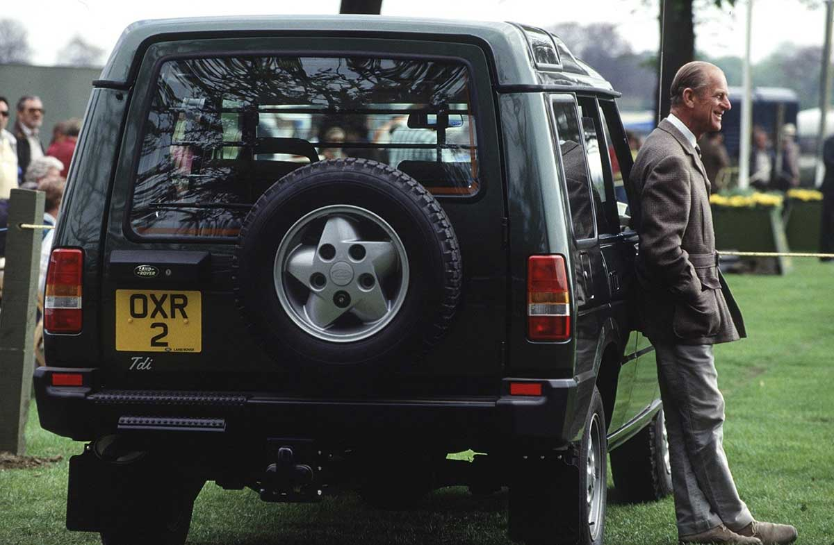 Prince Philip in front of his Rover