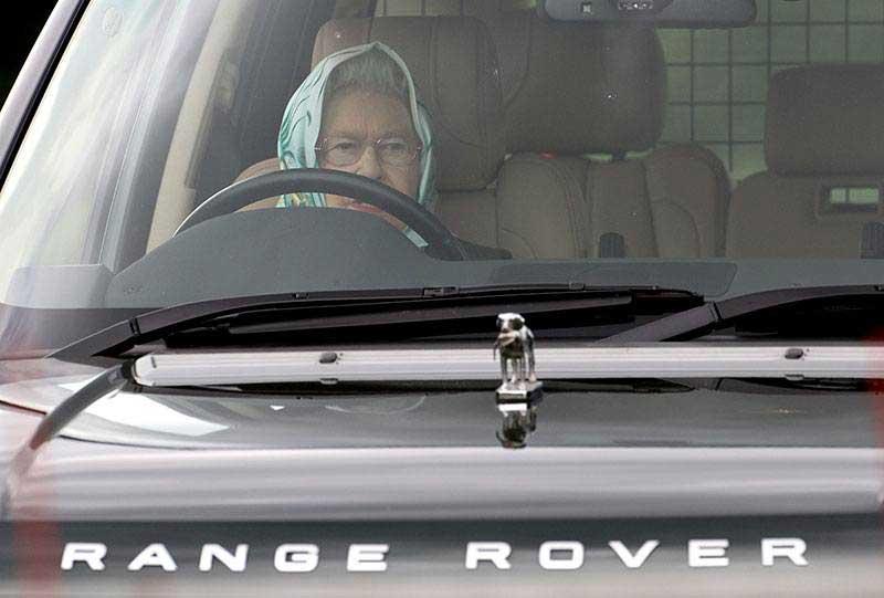 Queen Elizabeth driving a Range Rover