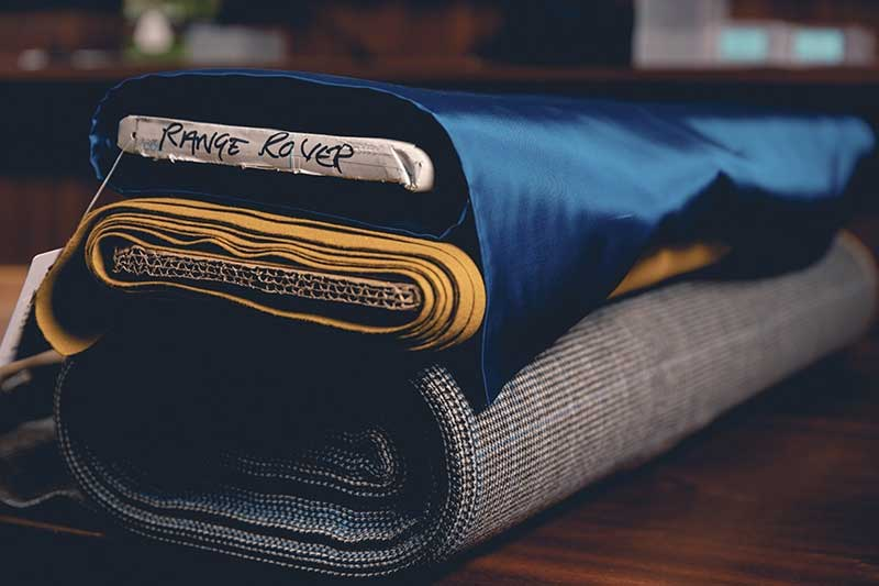 Clothier Henry Poole & Co. fabric for Range Rover inspired jacket
