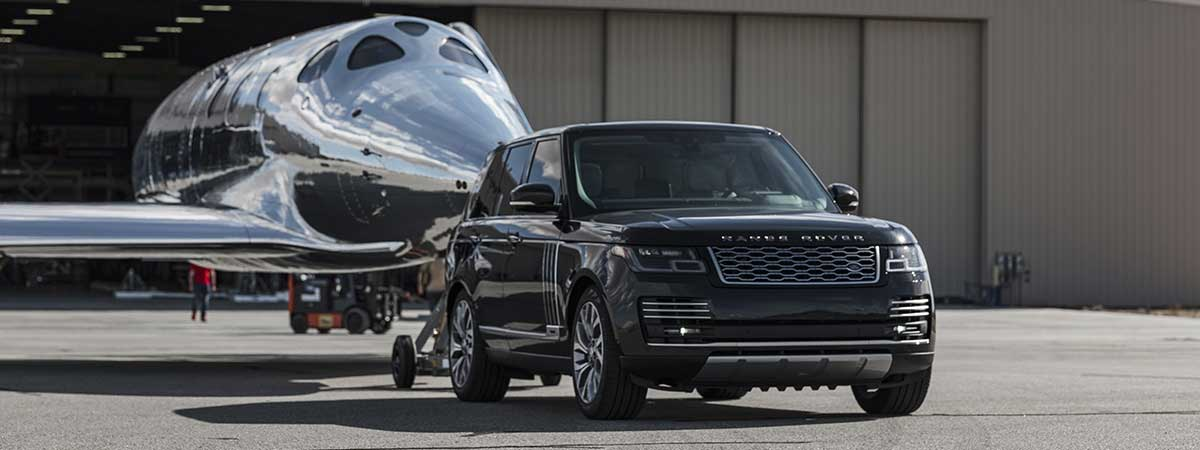 Range Rover Astronaut Edition showing strength by towing airplane